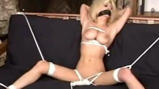 Bondage girl struggles in her restraints